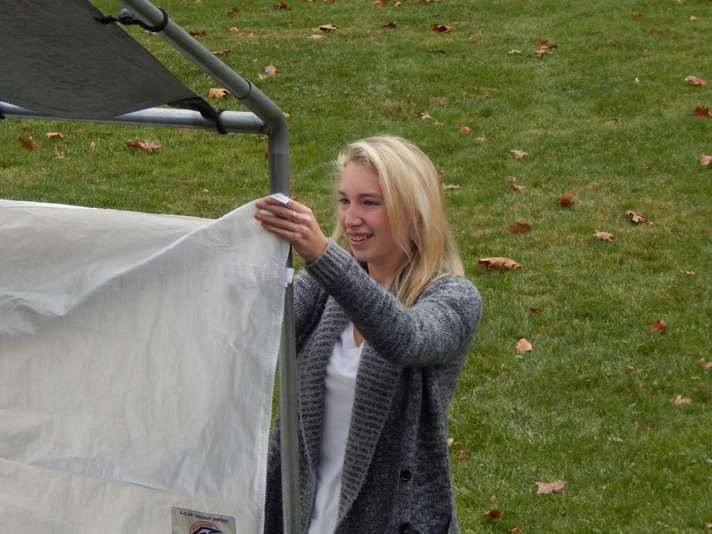 Liz Receives Canopy Set-up Training.